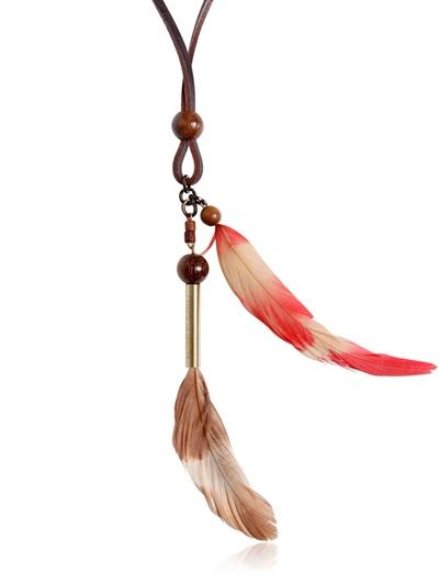 Collier en cuir, perles de bois et plumes DSquared (90 €)